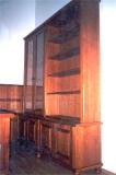 Könyvtár bútor - Cseresznyefából készült könyvszekrény falborítással